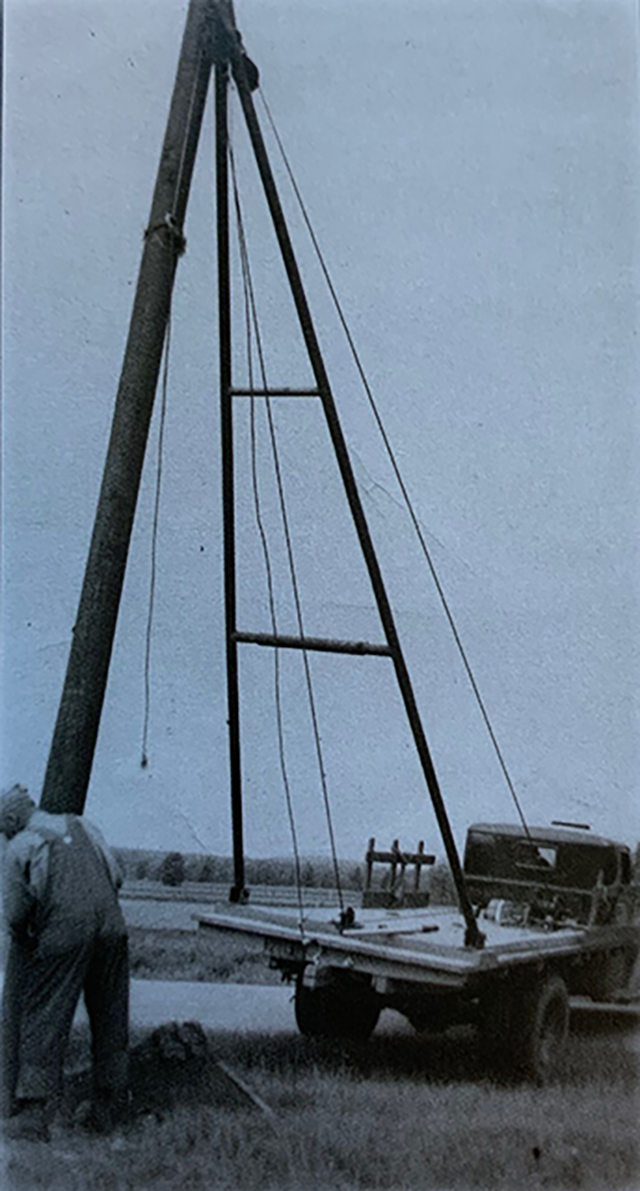 Setting electric poles in the late 1930s.